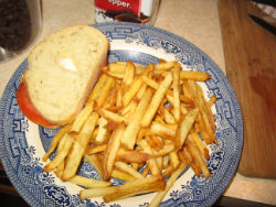 A lovely dinner of fries and a tomato sandwich
