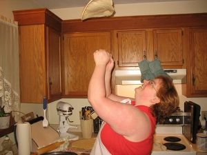 tossing pizza dough in the air