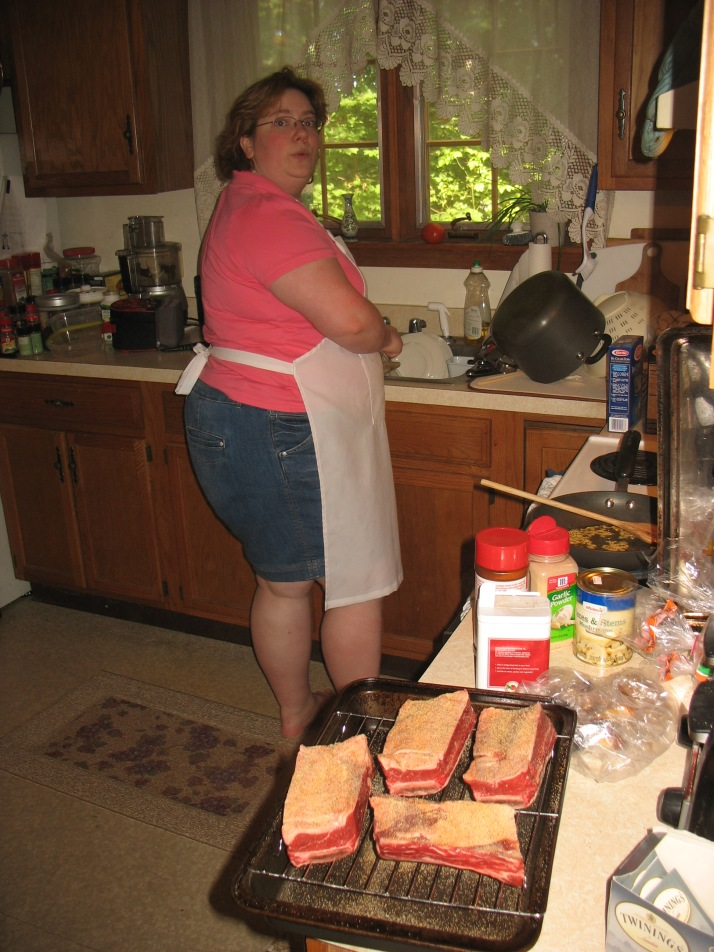 standing at the sink in the kitchen